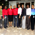Members of the senior management team pictured with Chairman Glen Christian.  Team members are, from left: Keisha Cardoza, Marketing Manager; Karlene Powell, Administrative Manager, Gary Cunningham, Sales Manager; Varena Henry, Operations Manager; and Yvonne Lewis, Accounts Manager; Lanna Bennett, General Manager; Tyrone Smith, Warehouse Manager – Outbound Logistics and Facilities; Kerri Miller-McDonald, HR Manager; and Kirk Christian, Warehouse Manager-Inbound Logistics and Inventory.
