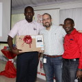 Owen Witter (left) shows off his prize laptop from Colgate-Palmolive.  With him are Miguel Falcon, Customer Development Manager for Colgate-Palmolive and Sales Manager, Gary Cunningham.