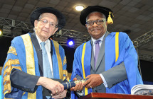 CEO and Chairman, Dr. the Hon. Glen Christian, OJ being conferred with the degree of Doctor of Laws, Honoris Causa by Chancellor of the University of Technology, the Most Hon. Edward Seaga. The honorary degree was presented on Thursday, November 3 during the Presentation of Graduates ceremony held at the National Arena.