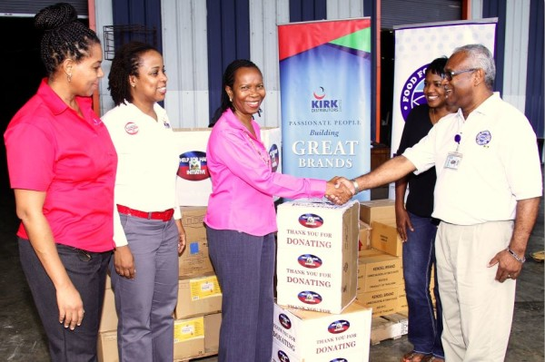 Ms. Ava Thompson, HR Coordinator at Federated Pharmaceutical (left), Mrs. Kerri Miller- McDonald, HR Manager at Kirk Distributors Ltd, and Mrs. Sonia Stewart-Gordon, Director of HR & Admin, Cari-Med Limited present our Haiti Relief donation to Food for the Poor representatives, Marsha Burrell – Rose, Marketing Manager, and Ron Burgess, Senior Director, Construction Services. The occasion was a recent visit by the team to FFP's Spanish Town offices.  The donation of toiletries, canned food items and over the counter (OTC) medications was contributed by employees of the three companies.
