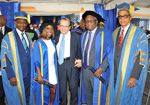 Dr. the Honourable Glen Christian and fellow awardee, Ambassador Shelly Ann Fraser Pryce pictured with University of Technology Chancellor, Most Hon. Edward Seaga. Sharing the moment are, Acting President Professor Colin Gyles (at left) and Pro Chancellor Richard Powell. Dr. Christian was conferred with the  degree of Doctor of Laws, Honoris Causa.